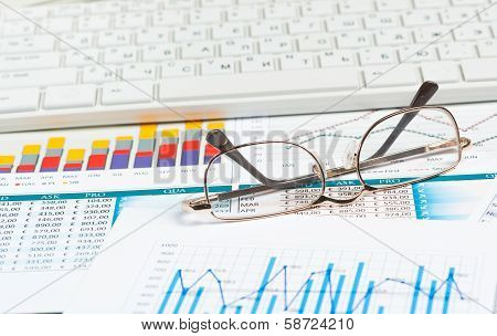 close-up glasses with business papers