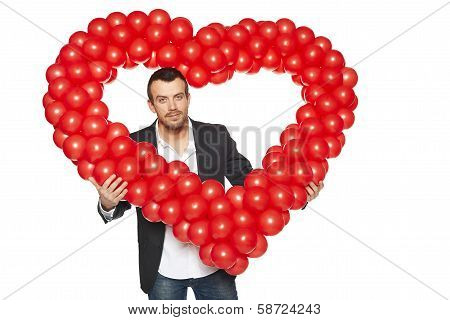 Man peeping through the heart shape