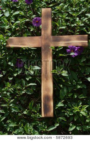 Wooden Cross on Shrub