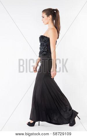 woman walking in long black elegant dress full body shot studio