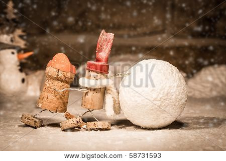 Wine Cork Figures, Concept Two Men Rolling A Snowball
