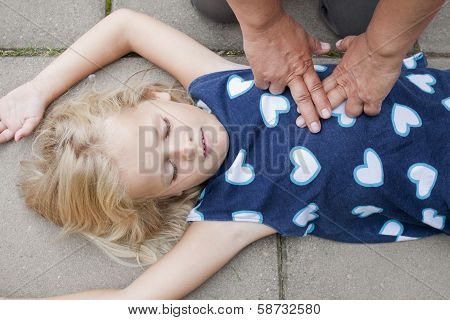 Young Child Receiving First Aid