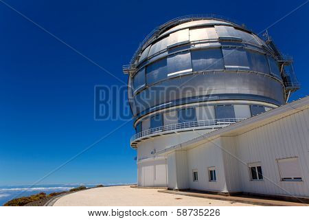 LA PALMA, CANARY ISLANDS, SPAIN - JULY 12, 2012: GTC Gran Telescopio de Canarias in a sunny day blue sky in ORM observatory at Roque de los Muchachos in La Palma, Canary, Spain, July 12, 2012