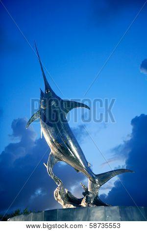 DANIA BEACH, FLORIDA - JAN 20, 2010: IGFA Sword Dance sculpture fountain of silver swordfish in Dania Beach, Florida, January 20, 2010. Sculptor is Kent Ullberg