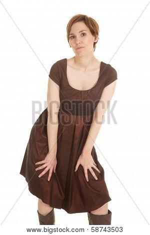 Latin Woman Brown Dress Hands On Legs