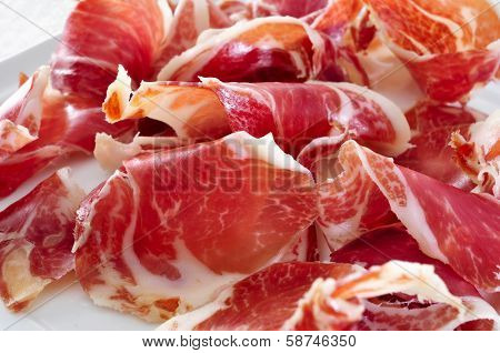 closeup of a plate with spanish serrano ham