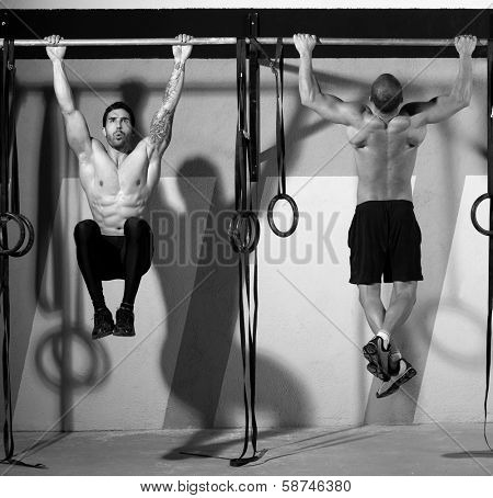 Crossfit toes to bar men pull-ups 2 bars workout exercise at gym