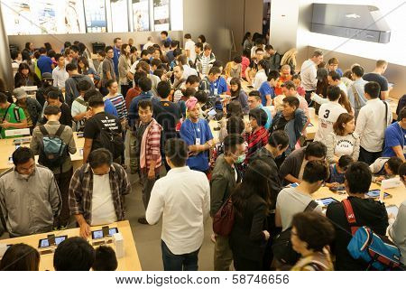 HONG KONG, CHINA - NOVEMBER 11, 2012: Buyers and shop assistants at Apple store in Hong Kong. Store is in a shopping center IFC Mall, it is very popular with locals and tourists visiting Hong Kong.