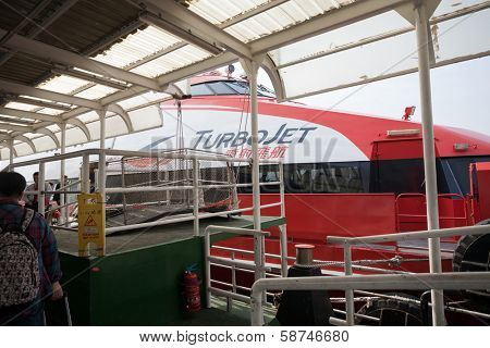 MACAU, CHINA - NOVEMBER 4, 2012: Fast passenger ferry hydrofoil Turbojet at berth marine terminal  Macau. Ferries run between Macau and Hong Kong, and mainland China.