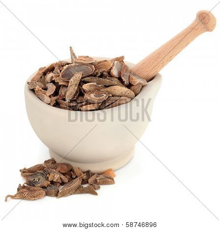 Turmeric curcuma tuber chinese herbal medicine in a stone mortar with pestle over white background. Yu jin.
