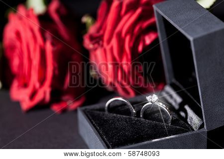 Engagement Ring With A Bunch Of Red Roses