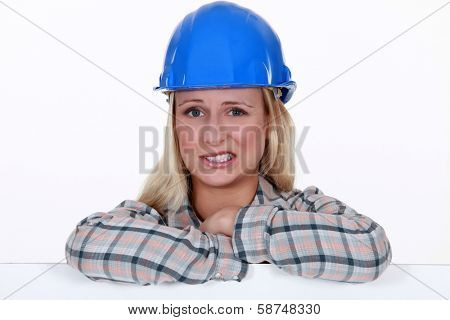 Apprehensive female builder