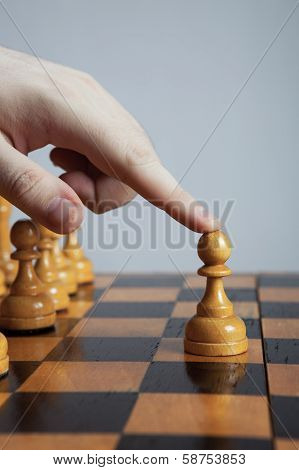 Man Makes A Move Chess Pawn