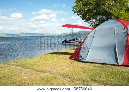 Tent on a camping site near a lake