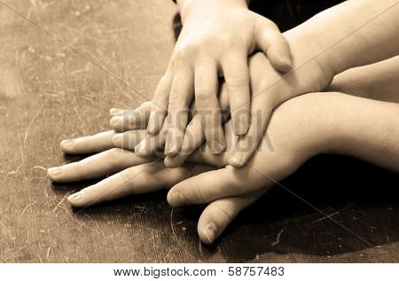 Several children hands on top of each other
