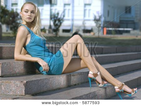 Sad Blonde In Turquoise Dress