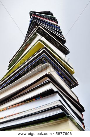 A Big Tower Of Many Books Vertical