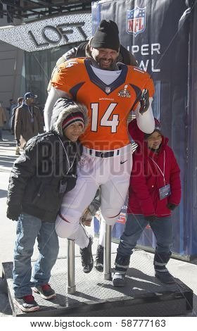 Unidentified Denver Broncos fans taken photo with Broncos team uniform on Broadway during SuperBowl