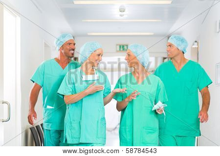 Hospital - medical surgery team is ready for the operation, the women and men wearing scrubs in a clinic