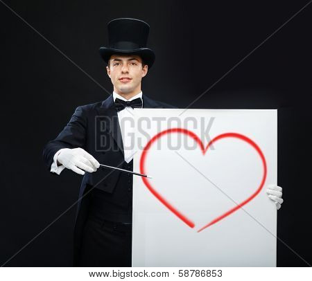 performance, circus, show and ove concept - magician in top hat with magic wand and white board showing trick