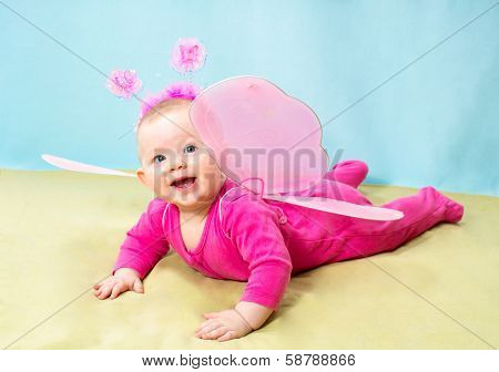 Pretty Child Girl, Dressed In Butterfly Costume On  Background The Concept Of Childhood And Holiday
