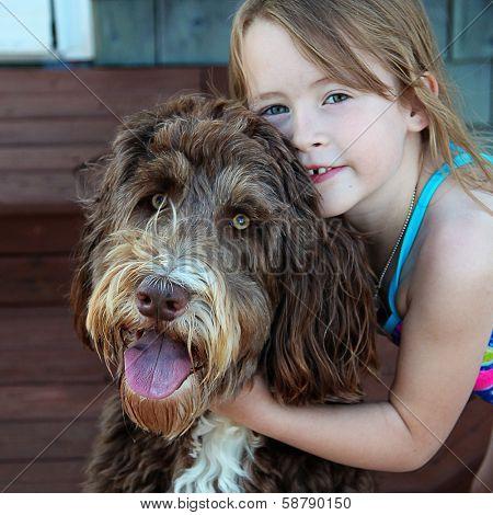 Little Girl with pet dog closeup