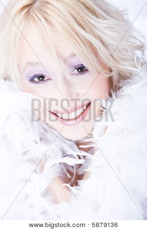 laughing young blond woman with white boa