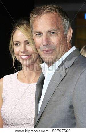 LOS ANGELES - JAN 15: Christine Baumgartner, Kevin Costner at the premiere of Paramount Pictures' 'Jack Ryan: Shadow Recruit' at TCL Chinese Theater on January 15, 2014 in Los Angeles, CA
