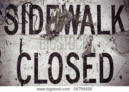 Damaged Sidewalk Closed Sign