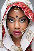 stock photo of sari  - Young Indian woman dressed in traditional clothing with bridal makeup and jewelry - JPG