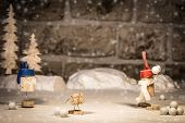 stock photo of snowball-fight  - Concept funny snowball fight wine cork figures - JPG