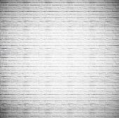 Abstract weathered texture of stained old dark stucco gray and painted white brick wall background i