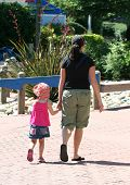 picture of mother daughter  - Woman walking daughter in the park - JPG
