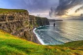 stock photo of cliffs moher  - Cliffs of Moher at sunset - JPG