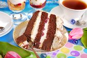 stock photo of tort  - piece of chocolate and cherry torte with meringues and cup of coffee - JPG