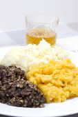 picture of haggis  - A traditional Scottish Haggis with potatoes and swede - JPG