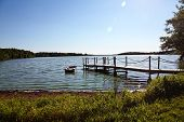 foto of dock a pond  - Pond with Boat Dock on Sunny Day - JPG