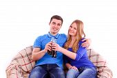 picture of coca-cola  - Young people sitting on a sofa and drinking Coca Cola on white background - JPG
