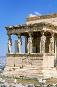 stock photo of poseidon  - The Erechtheion is an ancient Greek temple on the north side of the Acropolis of Athens in Greece which was dedicated to both Athena and Poseidon.