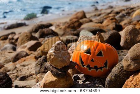 Halloween Pumpkin On The Rocky Beach