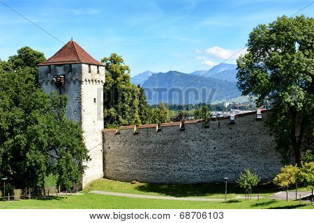 LUCERN, SWITZERLAND - JULY 3, 2014: The Musegg Wall and Schirmer Tower, Lucern. With nine guard towers, the old city walls were built between 1350-1408.