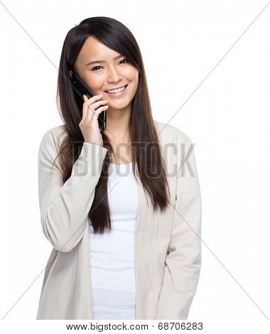 Asia young woman talking on mobile phone on white background