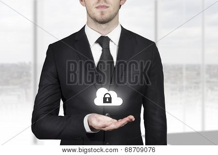 Businessman Holding Cloud Security Symbol