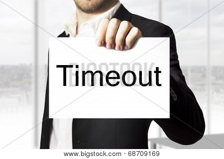 Businessman Holding Sign Timeout