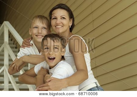 Smiling happy mother and sons