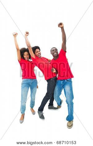 Excited football fans in red cheering on white background