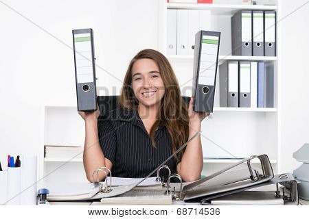 Young Woman Is Holding Two Files Up