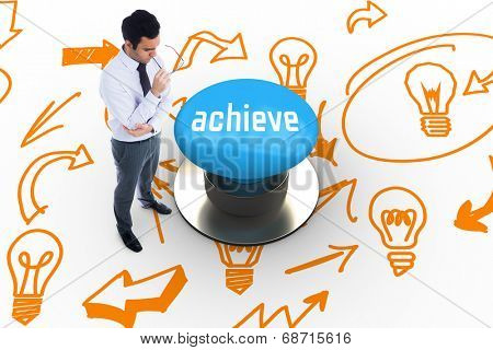 The word achieve and unsmiling businessman holding glasses against blue push button