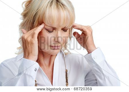 Isolated business woman with headache in studio
