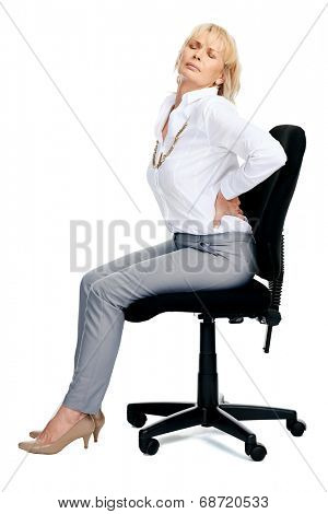 Business woman sitting on an office chair with back ache isolated